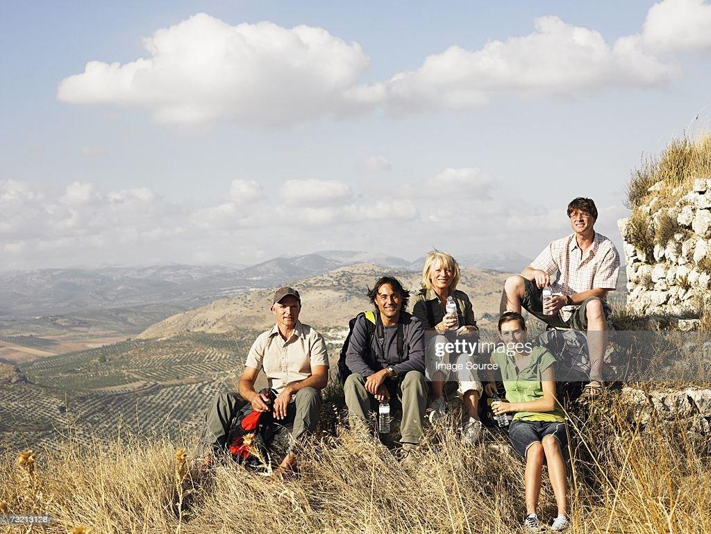 Tourists sat on a mountain : Stock Photo