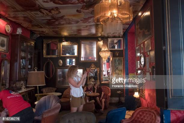 Tourists seen in a room reproducing typical brothel decoration at 'Pensao Amor' on July 14 2017 in Lisbon Portugal 'Pensao Amor' used to be a five...