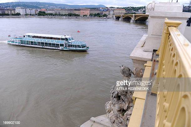 A tourists' ship swims on flood water of Danube River at Margarethe Bridge of Budapest downtown on June 4 2013 Hungarian Prime Minister Viktor Orban...