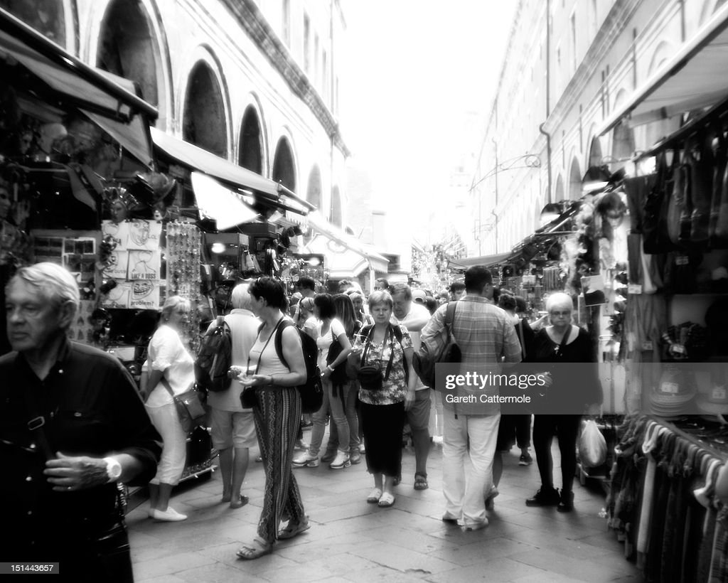 Tourists shop in the streets of Venice during the 69th Venice Film Festival at the Palazzo del Cinema on September 7, 2012 in Venice, Italy.