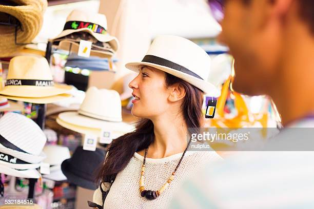 tourists shopping for a sunhat
