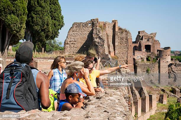 Tourists sightseeing at the Roman Forum in Rome, Italy