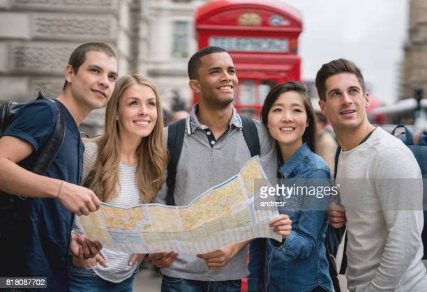 Tourists sightseeing in London and holding a map