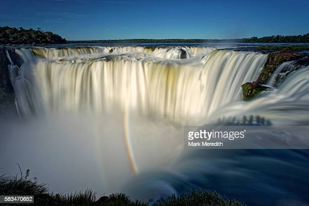 Tourists silhouetted on the Devil's Thoat, Iguazu Falls, garganta del diablo