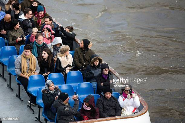 Tourists sit on an open top river cruise sightseeing boat on the River Thames in London UK on Tuesday Dec 29 2015 The odds are stacking up against...