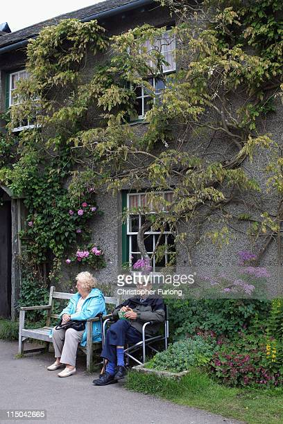 Tourists sit outside the home of Beatrix Potter on June 1 2011 in Sawrey United Kingdom The English Lake District is on the shortlist of Britain's...