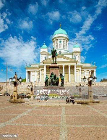 Tourists sitting on steps in front of Senate Square, Helsinki, Finland