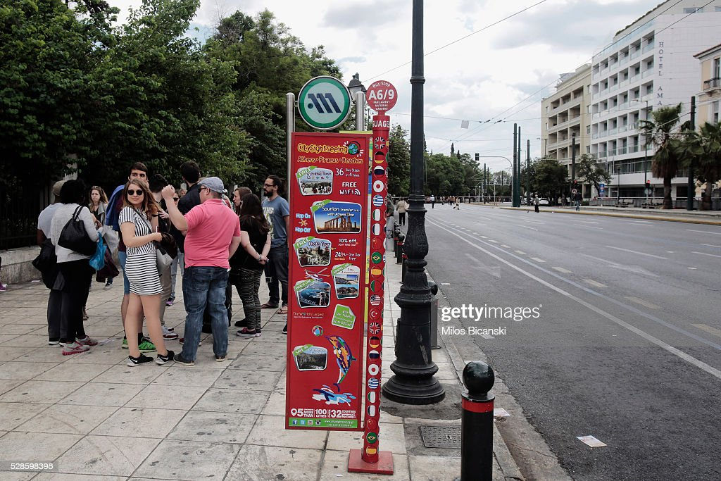 Tourists stand on empty streets during a 48-hour nationwide general strike on May 6, 2016 in Athens, Greece. Unions called the strike to protest against pension reforms that are part of Greece's third international bailout.