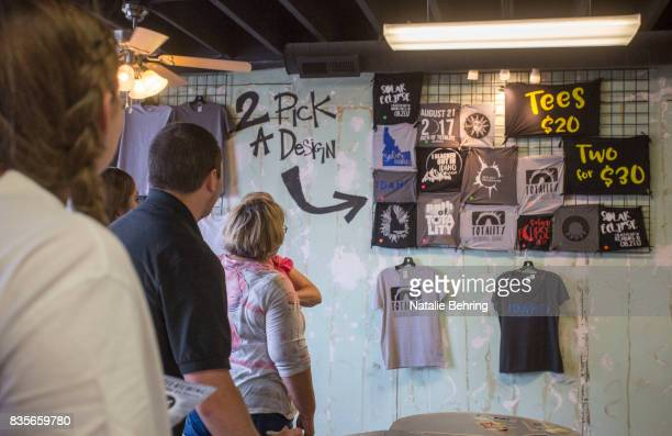 Tourists stop at a popup tshirt shop to buy an eclipse themed tshirt on August 19 2017 in Rexburg Idaho Locals in Rexburg are cashing in on travelers...