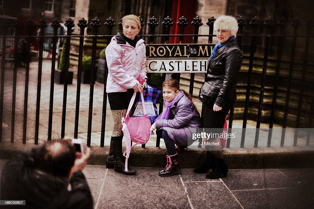 Tourists stop for a photograph near to Edinburgh Castle on the Royal Mile on April 23, 2014 in Edinburgh, Scotland. A referendum on whether Scotland should be an independent country will take place on September 18, 2014.