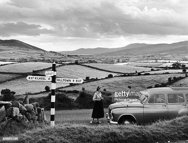 Tourists stop to consult a map near Kilkeel County Down Northern Ireland circa 1955