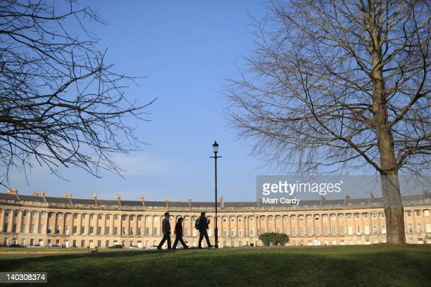 Tourists stop to look at the Royal Crescent in the heart of Georgian Bath on March 1 2012 in Bath England One of the most popular tourist...