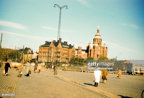 Tourists stroll through a square near Uspenski Cathedral in Helsinki Finland 1948