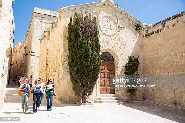 Tourists strolling in Mdina Old City, Malta