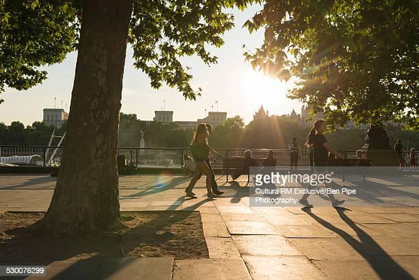 Tourists strolling on sidewalk, South Bank, London, UK