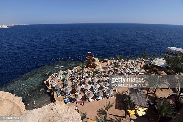 Tourists sunbathe in the Egyptian resort of Sharm elSheikh on November 7 2015 Britain had on November 4 suspended all flights to and from the resort...