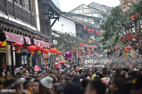 Tourists swarm into the main street of the ancient town of Ciqikou on January 30 2017 in Chongqing China Chinese are having seven days off in their...
