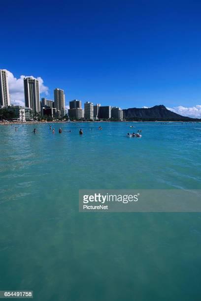 Tourists Swimming near Waikiki Beach