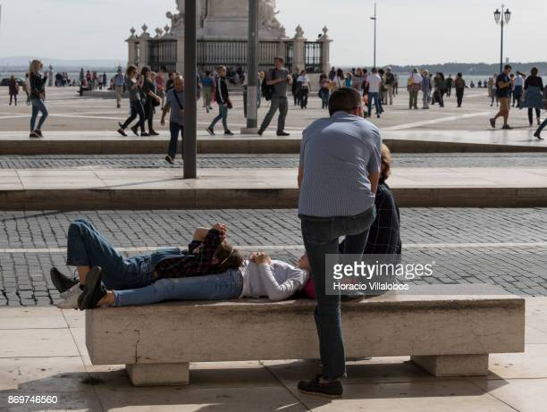 Tourists take a break in Praca do Comercio on October 21 2017 in Lisbon Portugal Although active all year round Portuguese tourist industry has gone...