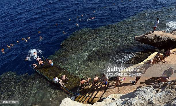 Tourists take a dip in the sea in the Egyptian resort of Sharm elSheikh on November 7 2015 Britain had on November 4 suspended all flights to and...