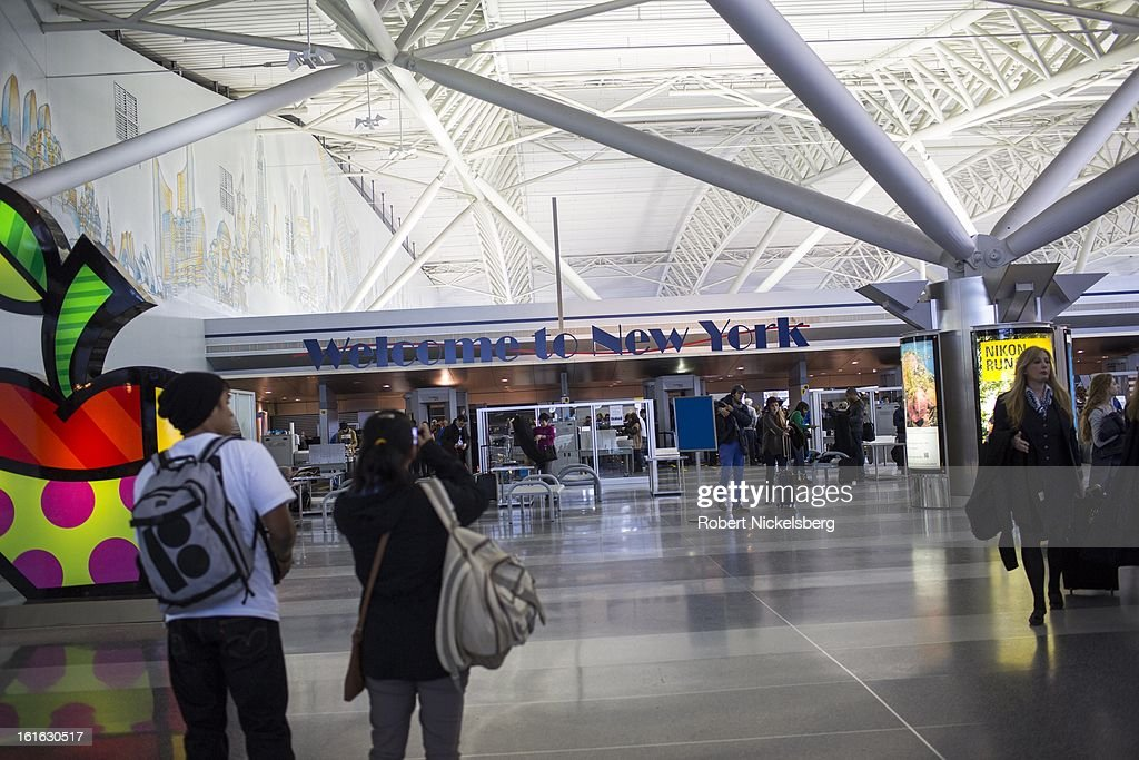 Tourists take a picture at the arrival hall February 3, 2013 at the John F. Kennedy International Airport in the Queens borough of New York.
