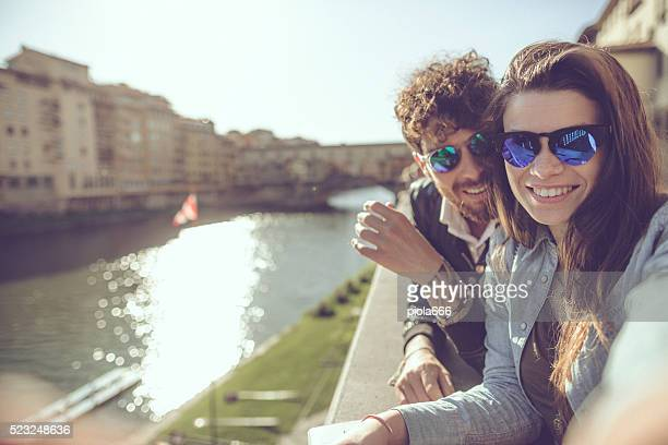 Tourists  take a selfie in Firenze with Ponte Vecchio