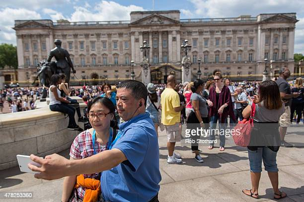 Tourists take a selfie in front of Buckingham Palace on June 24 2015 in London England The Queen may have to move out of Buckingham Palace her...