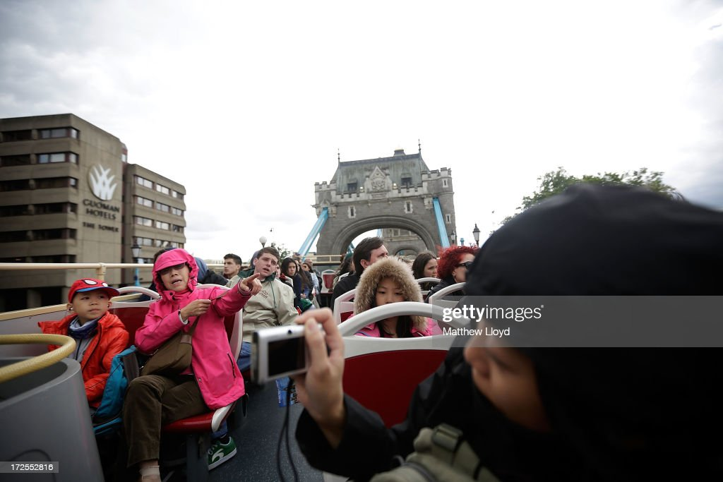 Tourists take an open top bus trip around London in grey cloudy weather on July 3, 2013 in London, England. Britain is experiencing an unusually wet summer, which scientists say me be repeated for up to the next ten years due to the warming of the Atlantic ocean.