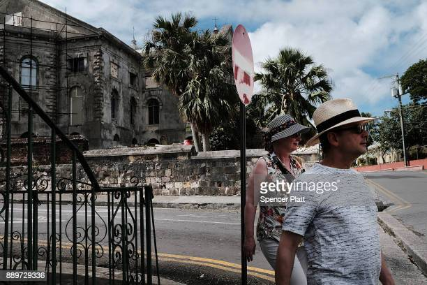 Tourists take in the sights on December 10 2017 in St John's Antiqua While it's sister island Barbuda was nearly destroyed in Hurricane Irma Antiqua...