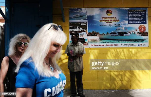 Tourists take in the sights on December 10 2017 in St John's Antiqua While it's sister island Barbuda was nearly destroyed by Hurricane Irma Antiqua...