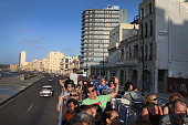 Tourists take in the sites from a double decker tour bus of Havana a day after the second round of diplomatic talks between the United States and...