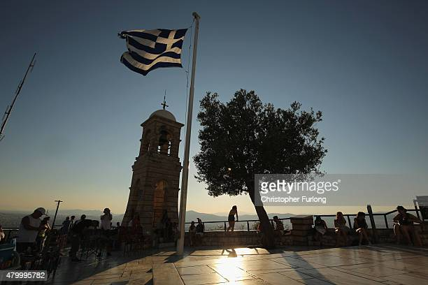 Tourists take in the view over the city of Athens from Lycabettus Hill on July 8 2015 in Athens Greece Eurozone leaders have offered the Greek...