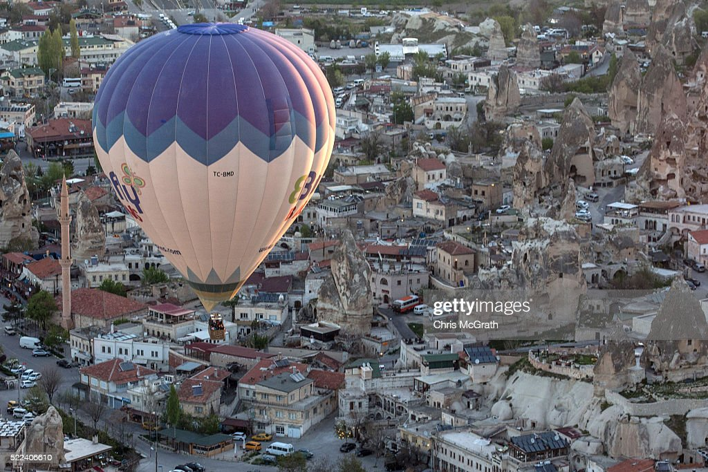 Tourists take in the view over the town of Goreme during a hot air balloon ride on April 17, 2016 in Nevsehir, Turkey. Cappadocia, a historical region in Central Anatolia dating back to 3000 B.C is one of the most famous tourist sites in Turkey. Listed as a World Heritage Site in 1985, and known for its unique volcanic landscape, fairy chimneys, large network of underground dwellings and some of the best hot air ballooning in the world, Cappadocia is preparing for peak tourist season to begin in the first week of May. Despite Turkey's tourism downturn, due to the recent terrorist attacks, internal instability and tension with Russia, local vendors expect tourist numbers to be stable mainly due to the unique activities on offer and unlike other tourist areas in Turkey such as Antalya, which is popular with Russian tourists, Cappadocia caters to the huge Asian tourist market.