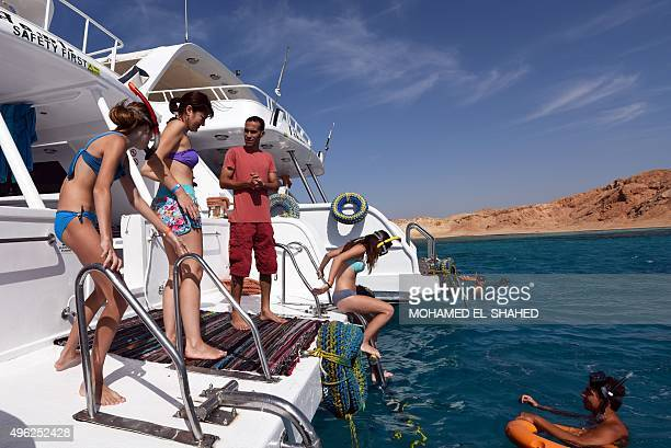 Tourists take part in a diving session in the Egyptian resort of Sharm elSheikh on November 8 2015 Britain and the United States as well as...