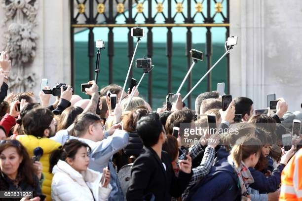Tourists take photo on their phones during the launch of The Queen's Baton Relay for the XXI Commonwealth Games at Buckingham Palace on March 13 2017...
