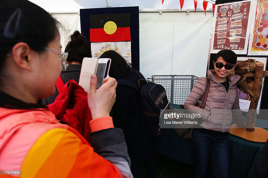 Tourists take photographs at the Australian Museum display booth during a public NAIDOC celebration at Hyde Park on July 8, 2013 in Sydney, Australia. NAIDOC is a celebration of Aboriginal and Torres Strait Islander cultures and an opportunity to recognise the contributions of Indigenous Australians.