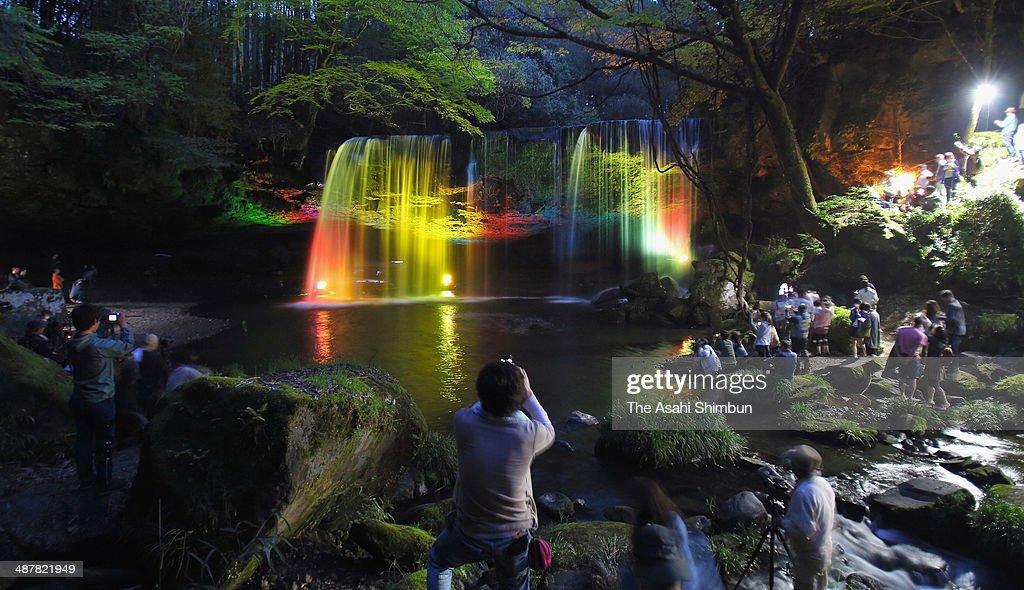 Tourists take photographs of the illuminated Nabegataki Fall on May 2, 2014 in Oguni, Kumamoto, Japan. The annual illumination takes place May 3-6.