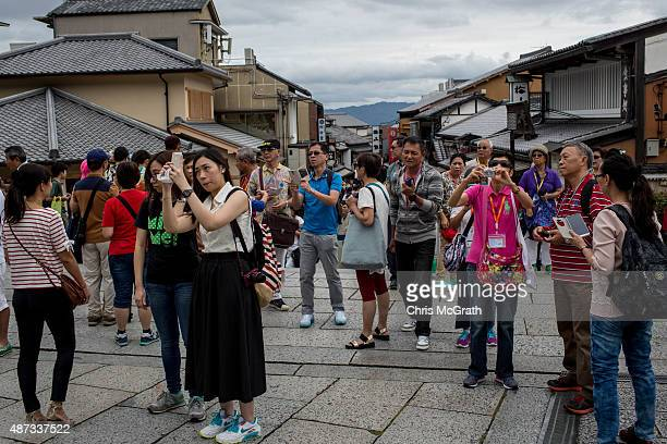 Tourists take photos at the entrance to the Kiyomizu Temple on September 7 2015 in Kyoto Japan The famous city of Kyoto is going through a massive...