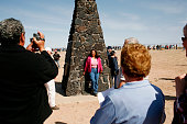 Tourists take photos at the monument at the Trinity Site which is where the US military first detonated the world's first atom bomb in July of 1945...