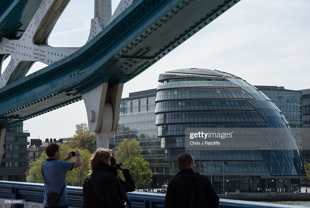Tourists take photos from Tower Bridge with a view of City Hall, the headquaters of the Mayor of London and the London Assembly on the southbank of the River Thames as Londoners vote for a new Mayor on May 5, 2016 in London, United Kingdom. Today,dubbed 'Super Thursday',sees the British public vote in countrywide elections to choose members for the Scottish Parliament, the Welsh Assembly, the Northern Ireland Assembly, Local Councils, a new London Mayor and Police and Crime Commissioners. There are around 45 million registered voters in the UK and polling stations open from 7am until 10pm.