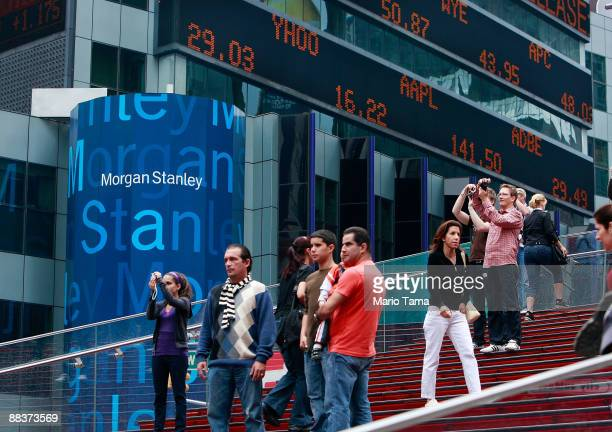 Tourists take photos in front of Morgan Stanley headquarters June 9 2009 in New York City Morgan Stanley is one of ten lenders that won US Treasury...