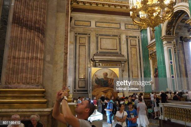 Tourists take photos of interior of the Saint Isaac's Cathedral August 12 2017 in Central Saint Petersburg Russia Saint Isaac's Cathedral or...