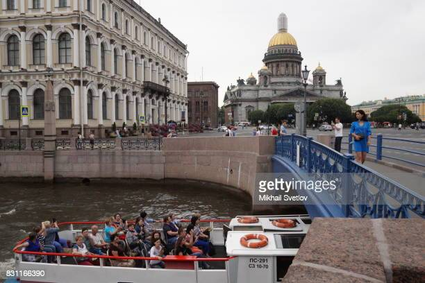 Tourists take photos of the Saint Isaac's Cathedral August 12 2017 in Central Saint Petersburg Russia Saint Isaac's Cathedral or Isaakiyevsky Sobor...