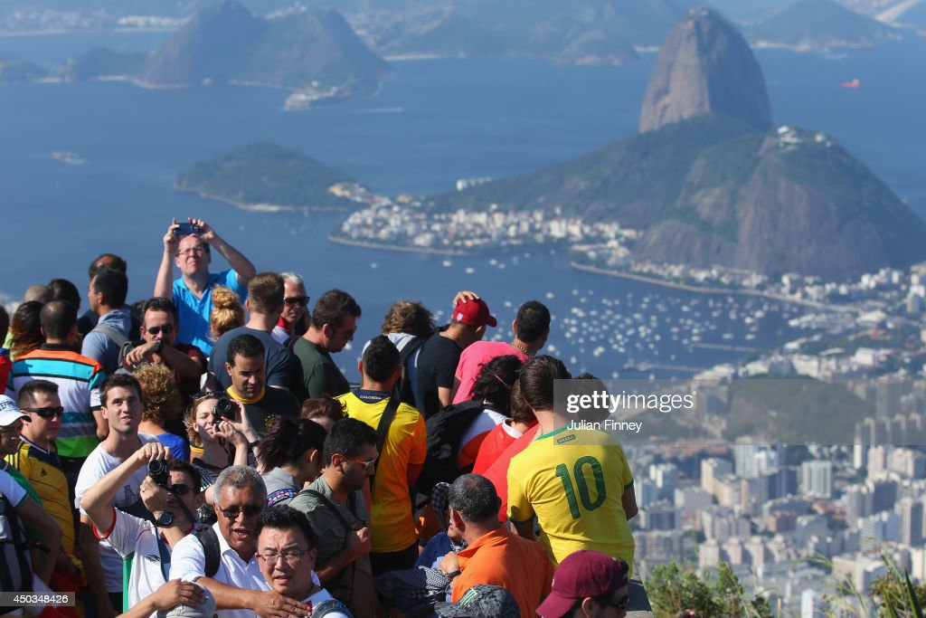 Tourists take photos of the view by the Christ Redeemer Statue on June 9, 2014 in Rio de Janeiro, Brazil.
