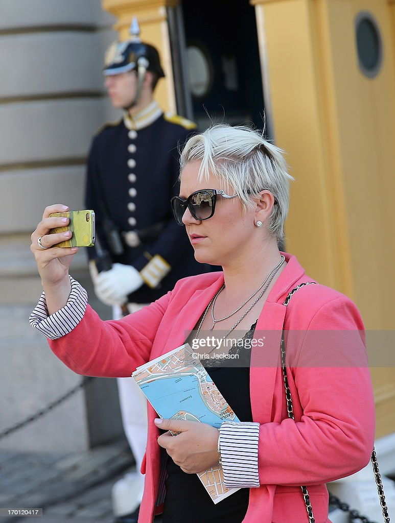 Tourists take photos outside the Royal Palace as preparations for the wedding of Princess Madeleine of Sweden and Christopher O'Neill continues on June 7, 2013 in Stockholm, Sweden.