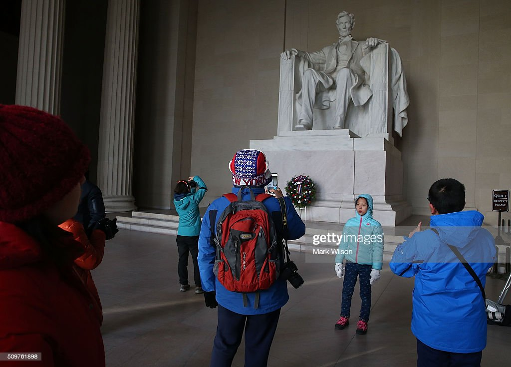 Tourists take pictures after a wreath laying ceremony at the Lincoln Memorial, February 12, 2016 in Washington, DC. The Military District of Washington held a Presidential full honor wreath laying ceremony to commemorate Abraham Lincoln's 207th birthday.