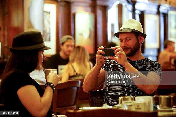 Tourists take pictures at Cafe Tortoni on January 03 2015 in Buenos Aires Argentina Cafe Tortoni was founded in 1858 by Jean Touan a French inmigrant...