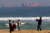 Tourists take pictures in a popular beach of Viña del Mar on May 17 2015 in Viña del Mar Chile Viña del Mar will be one of the eight host cities of...