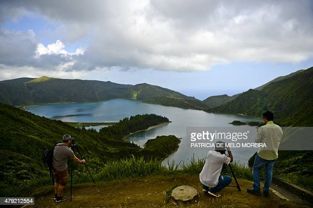 Tourists take pictures of the Fire Lagoon on the Sao Miguel island in Azores on July 1 2015 AFP PHOTO/ PATRICIA DE MELO MOREIRA
