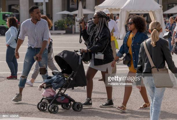 Tourists take pictures while strolling in Praca do Comercio on October 21 2017 in Lisbon Portugal Although active all year round Portuguese tourist...